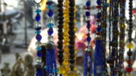 Necklaces in light at shop in India