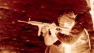 Negative shot of kneeling soldier shooting M4 rifle