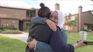 Neighbours of suspected shooters are shocked and saddened by the rampage in San Bernardino that claimed the lives of 14 people