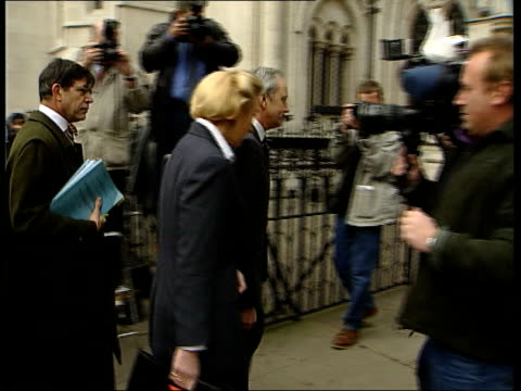 Neil Hamilton libel action against Al Fayed ITN London The Strand PHOTOGRAPHY*** Hamilton and wife Christine posing for photocall and along to court...