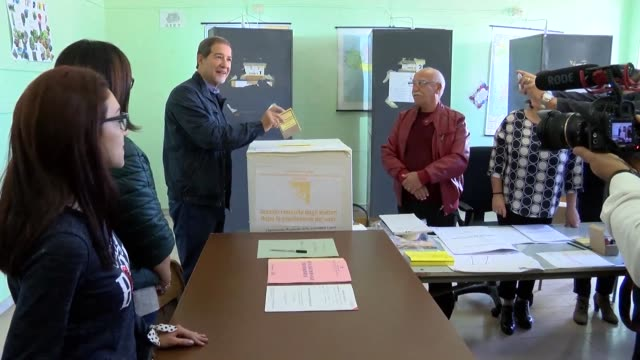 Nello Musumeci the candidate backed by Silvio Berlusconi's centre right party in Sicily's regional election casts his vote in his home town near...