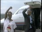 Nelson Mandela and wife Winnie make triumphant gesture on runway after arriving in Johannesberg
