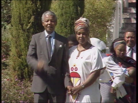 Nelson Mandela and wife Winnie pose for press on the day following his release from prison