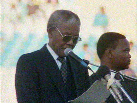Nelson Mandela speaks to a crowd of African National Congress supporters about apartheid on the eve of the repeal of the Population Registration Act