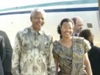 Nelson Mandela stands on tarmac at Heathrow Airport after arriving from South Africa Accompanied by companion Graca Machel whom he subsequently...