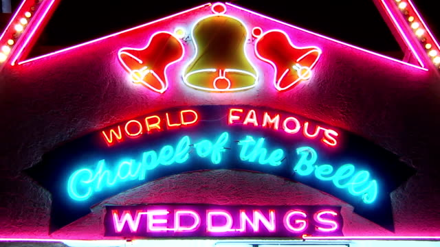 Neon lights of sign World Famous Chapel of the Bells Weddings on Las Vegas Boulevard South NV What happens in Vegas stays in Vegas