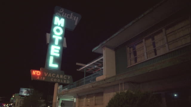 WS, LA, Neon motel sign illuminated at night, Reno, Nevada, USA
