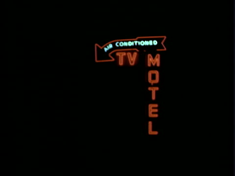 Neon sign in red and blue 'Air Conditioned TV MOTEL' Neon sign for motel at night on January 01 1953 in Los Angeles California