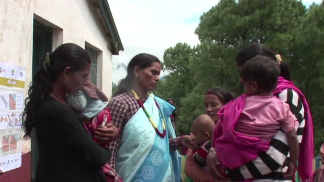 Nepalese housewife Bhumisara Upadhyay visits pregnant women on a mission to lower newborn deaths in the Himalayan nation with a simple tube of gel