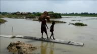 Nepali flood victims were salvaging what was left of their belongings and living in makeshift shelters Tuesday in Gaur in the aftermath of deadly...