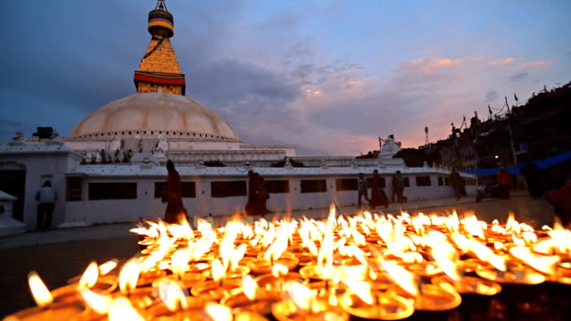 KATHMANDU, NEPAL - APRIL 29, 2015: Nepali residents take part in a candle lighting ceremony for those lost in the earthquake on a street in Kathmandu, Nepal