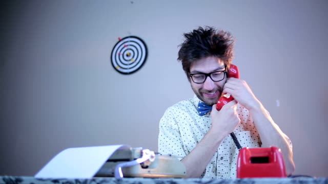 Nerdy guy talking on phone