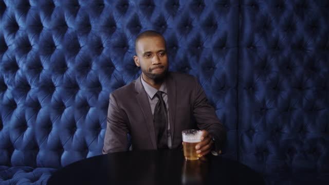Nervous Man Waiting in Bar