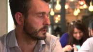 Net UK migration falls to lowest level in three years London Two men drying glasses behind bar in Charlotte's W5 restaurant Alex Wrethman interview...