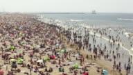 Netherlands, Scheveningen, near The Hague, Summertime on the beach, People sunbathing and enjoying the sea water