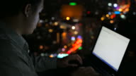 Network engineer working latenight at rooftop of building