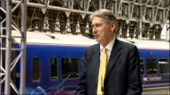 Network Rail announces Great Western rail investment Phil Hammond launch at Paddington Philip Hammond MP waiting to deliver speech People listening...