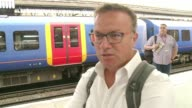 Network Rail apologises after major project to upgrade Waterloo station overran ENGLAND London EXT South West train arriving on platform People along...