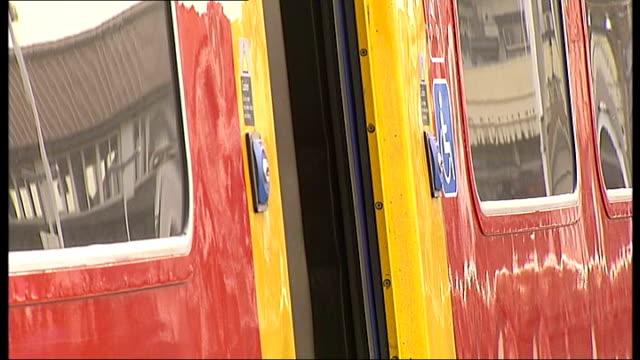 General views of trains along track rail passengers Rail passengers waiting on railway station platform / Train arriving at platform passengers...