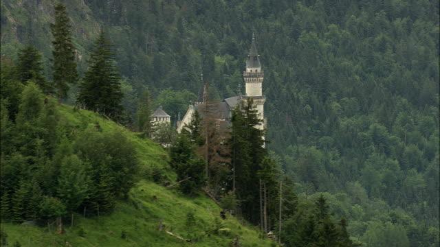 AERIAL Neuschwanstein Castle on hillside, Neuschwanstein, Bavaria, Germany