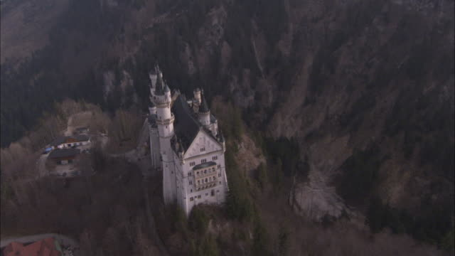 Neuschwanstein Castle sits on a hill in the Bavarian countryside. Available in HD