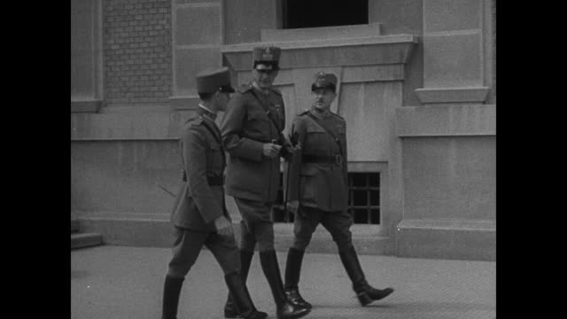 New buildings in Albania MajorGeneral Sir Jocelyn Percy walking w/ two Colonels Albanian soldiers standing at attention MajorGeneral Percy having tea...