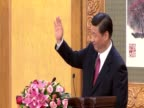 New Chinese leader Xi Jinping and his team wave and leave the stage in the Great Hall of the People after speech about the challenges ahead