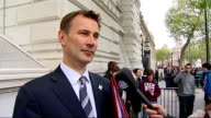 First Cabinet meeting departures and interviews Jeremy Hunt through gates and speaking on mobile phone SOT / Jeremy Hunt interview SOT The first...
