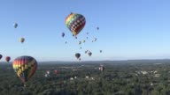 New Jersey Balloon Festival Hot AIr Balloons Fly Over Green Fields on July 26 2013 in Readington New Jersey