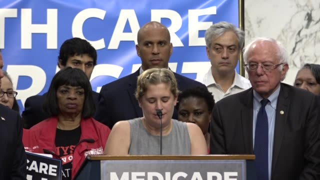 New mother Rebecca Wood tells media and supporters of universal health care coverage about her story of dealing with the health care industry on the...