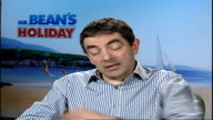 New Mr Bean film / interview Rowan Atkinson SEQUENCE Reporter saying there ought to be kids in interview disappears and reappears with kids Cameron...