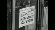 New Orleans harbor Street w/ carriage Cafe sign 'Dixieland Jass Band New Style Rhythm' CU Hand playing piano w/ cigarette resting on key 1917...