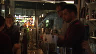 New powers to help pay the nation's £11bn a year bill for alcoholrelated crime and disorder come into effect next week Shows interior night shots of...