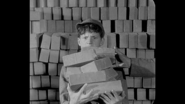 A new reform school inmate (Junior Durkin) is taught how to lay bricks