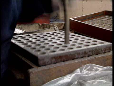 New safe method of producing fireworks ENGLAND Yorkshire Huddersfield INT CMS Fireworks being manufactured by hand in shed Woman making fireworks by...