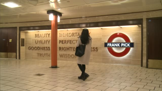 New scultpure at Piccadilly Station to commemorate Frank Pick ENGLAND London Piccadilly INT Woman along past Frank Pick sculpture General view Frank...