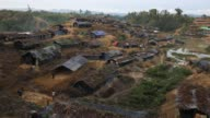 A new settlement of Rohingya refugees begins to form in hills off the main road on September 10 2017 in Whaikhyang Bangladesh Recent reports have...