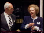 London 10 Downing Street Baroness Thatcher with Denis Thatcher on steps of Number 10 Downing Street making threefingered salute