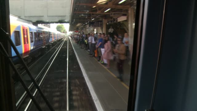 New South West Trains Managing Director promises improvements to service DATE London View of commuters on crowded platform seen from front of train...
