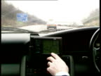 New 'Traffic Master' to warn motorists ENGLAND London M25 MS View of traffic ahead on motorway with driver at wheel CS Traffic Master screen on...