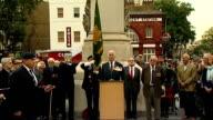 New war memorial unveiled in Camden Bugler playing bugle/ close shot of Burma Star flag held by veteran/ Viscount Slim and Tony Garizio unveil war...