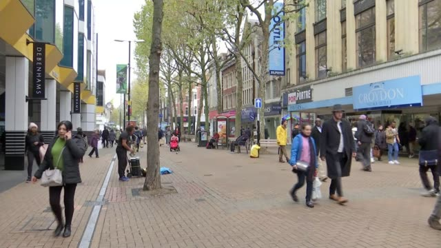 New Westfield Shopping Centre planned for Croydon ENGLAND London Croydon EXT Various shots people along high street at busker plays saxophone PAN...