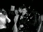 Scottish Association gathering in London ENGLAND London Victoria Hall Piper playing bagpipes SOF and dancers doing Gay Gordons / GV MS dancers doing...