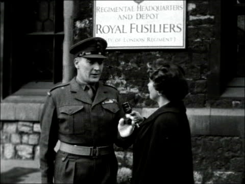 London Tower of London EXT Troops marching at Tower / Sergeant Major of Royal Fusiliers shouting order and reporter asks him if he has any New Year...