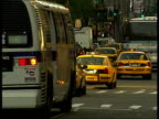 Brooklyn Bridge / Macy's / Jetlagged Ken Livingstone arriving in New York / Boats along River / Traffic along Traffic taxis buses along busy Broadway...
