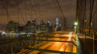 USA, New York City, Downtown Financial district of Manhattan, One World Trade Center and the Brooklyn Bridge - Time lapse