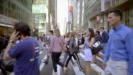 new york city manhattan street scene of people commuting. urban lifestyle background