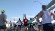 LA MS New York City Marathon participants running across Verrazano-Narrows Bridge / New York, NY, USA