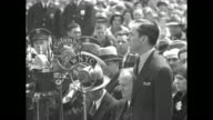 CU New York City Mayor Jimmy Walker speaks at opening ceremony of Floyd Bennett Field in Brooklyn 'WNYC' and 'Columbia' microphones stand in front of...