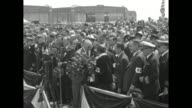 New York City Mayor Jimmy Walker stands nearby as Mrs Floyd Bennett steps to the microphone during the opening ceremony for Floyd Bennett Field in...